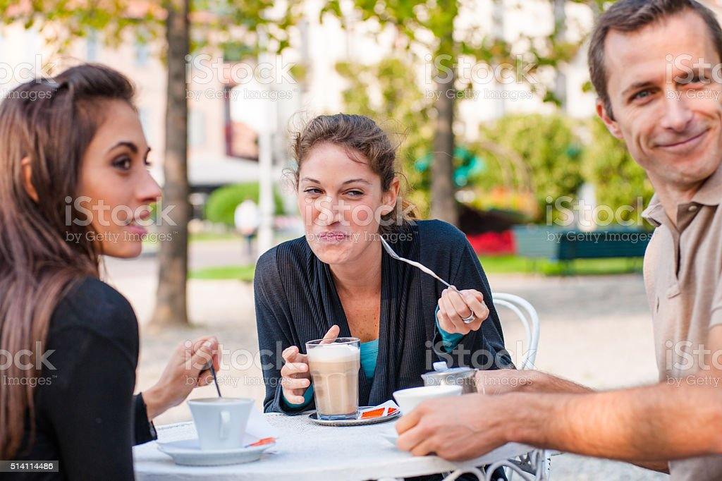 friends doing breakfast at the cafe together stock photo