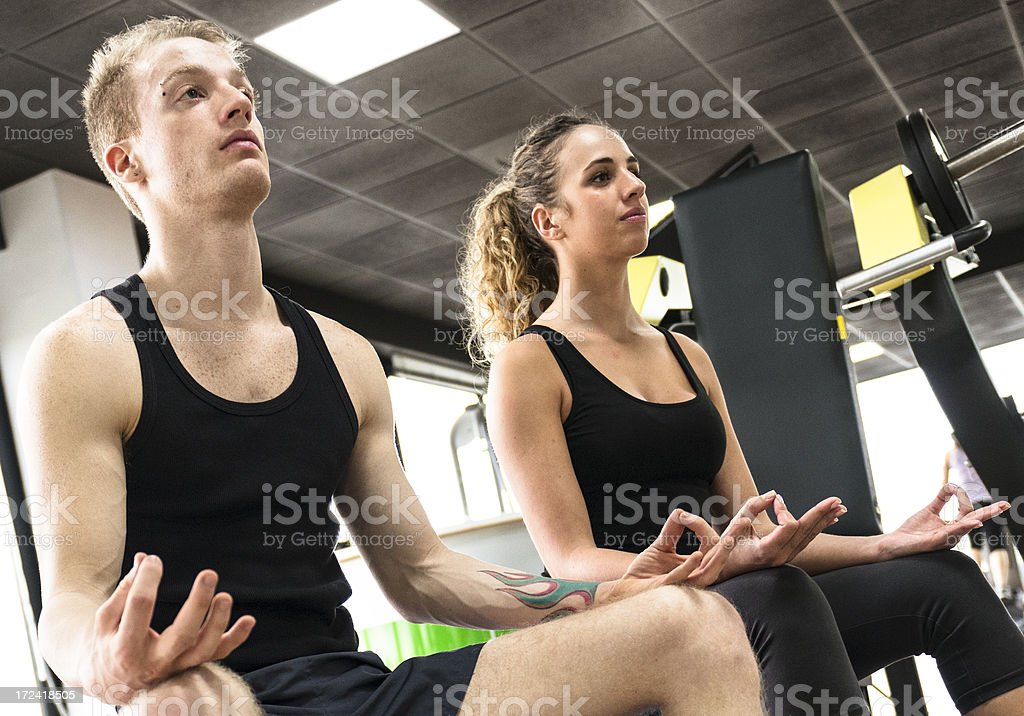 Friends doing yoga inside a gym royalty-free stock photo