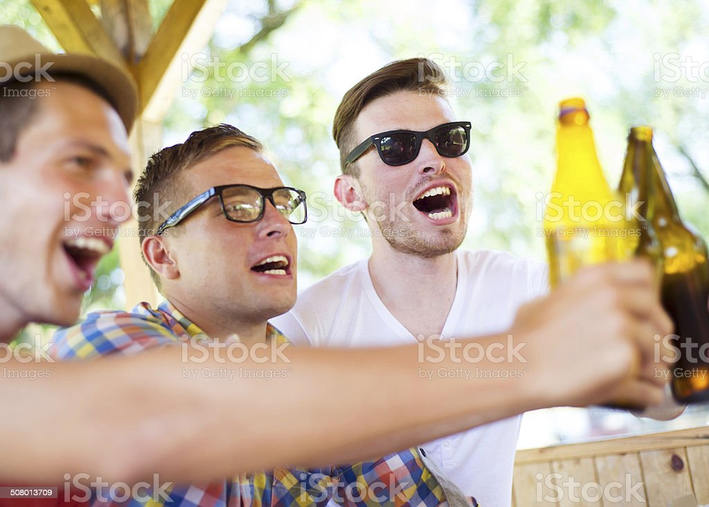 Friends drinking and chatting stock photo