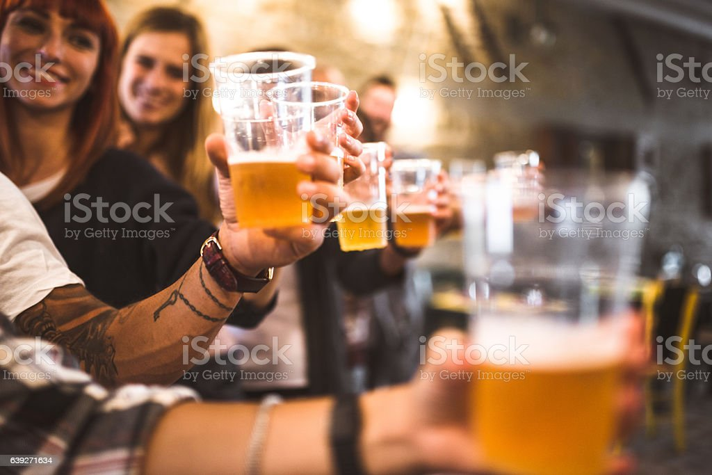 friends drinking beer at the oktoberfest stock photo