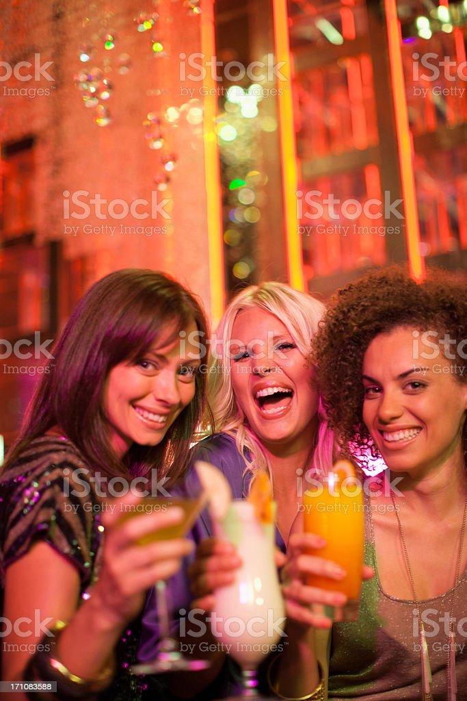 Friends drinking cocktail in nightclub stock photo