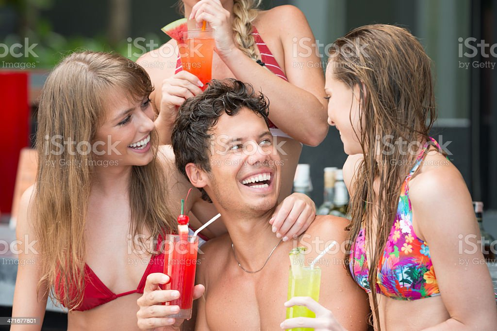 Friends drinking Cocktails at the Pool Bar royalty-free stock photo
