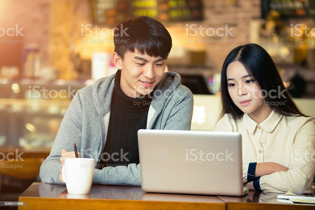 Friends drinking coffee together stock photo