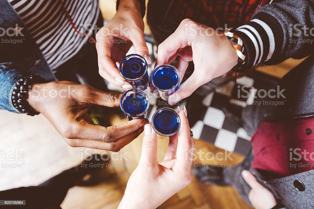 Friends drinking shots, high angle view stock photo