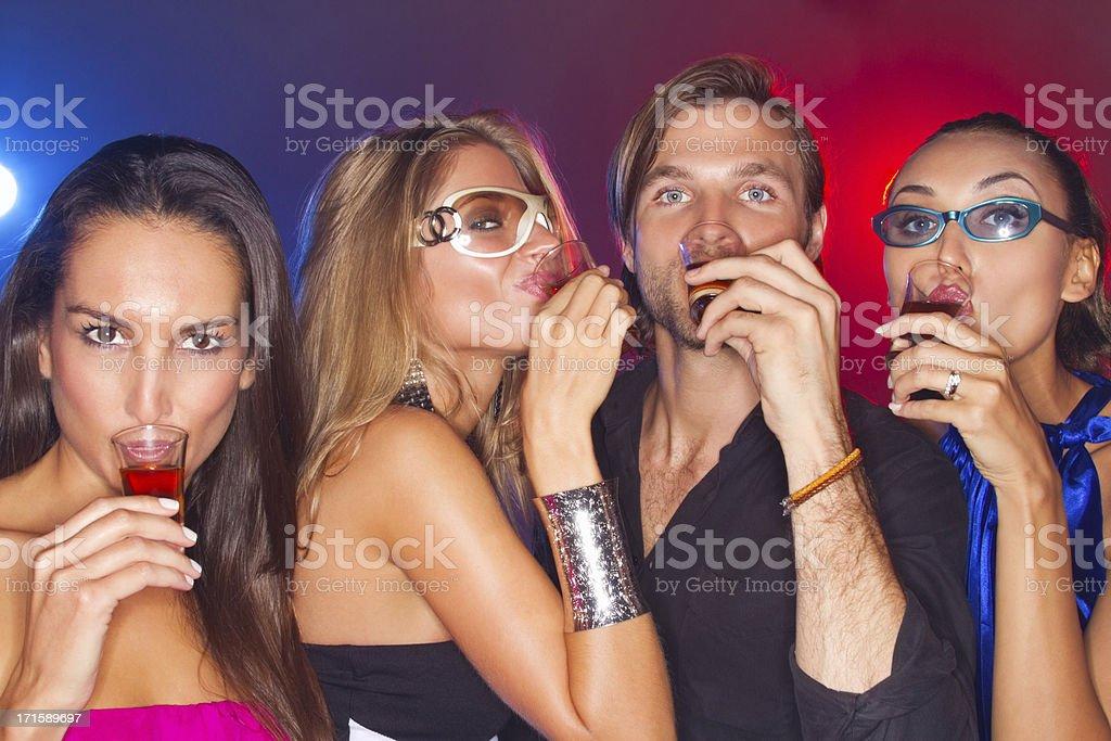 Friends Drinking Shots royalty-free stock photo
