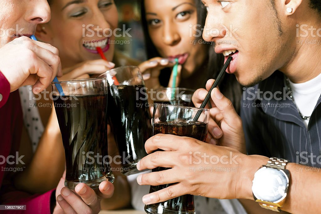 Friends drinking soda in a bar royalty-free stock photo