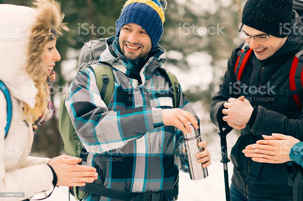 Friends Drinking Tea On Hiking. stock photo