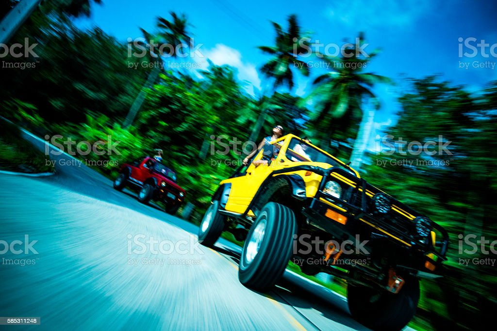 Friends driving 4x4 cars down the road stock photo