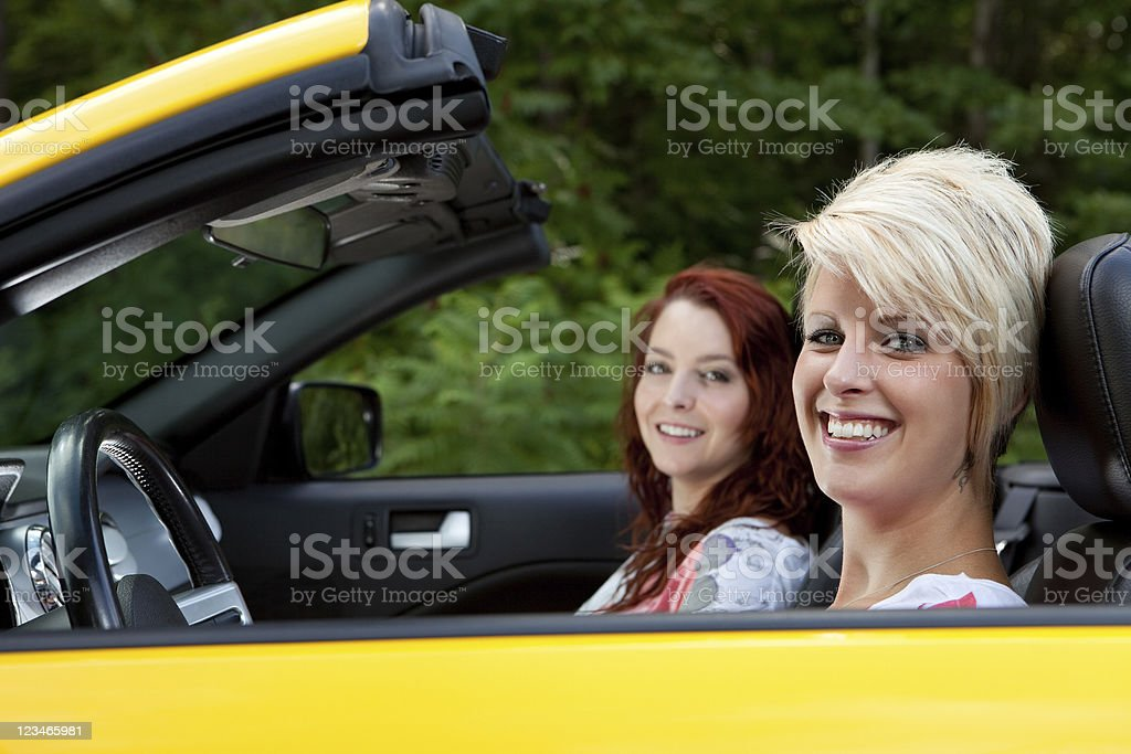 Friends driving a convertible stock photo