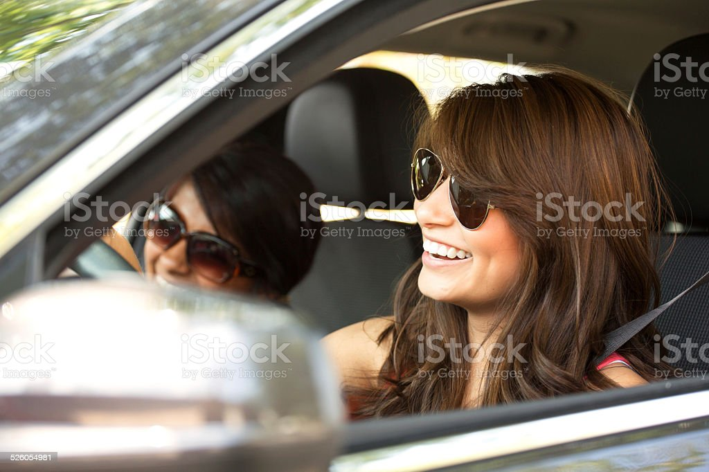 Friends Driving Wearing Sunglasses stock photo