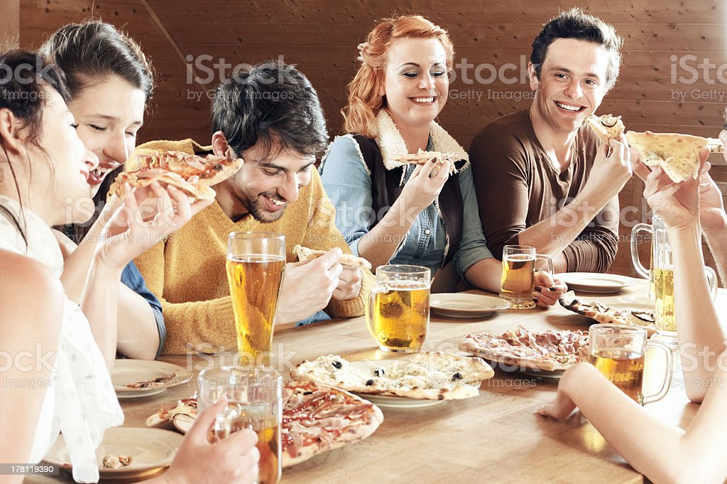 Friends eating and having fun stock photo