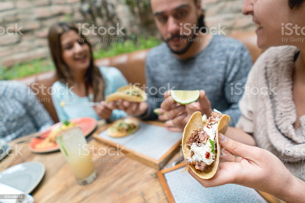 Friends eating at a Mexican restaurant stock photo