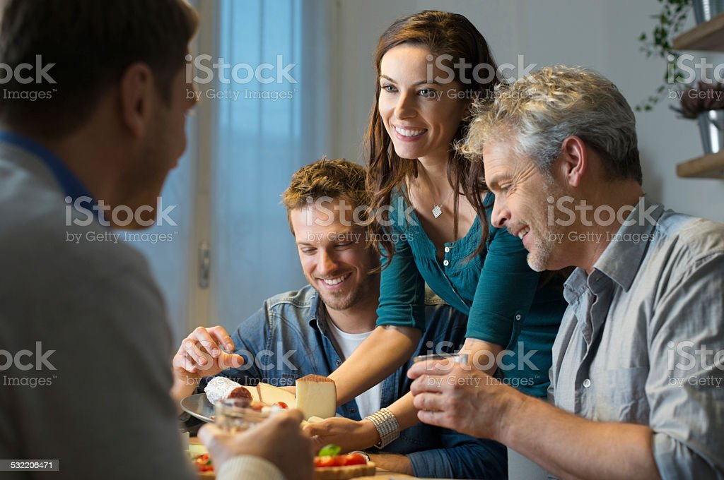 Friends eating at home stock photo