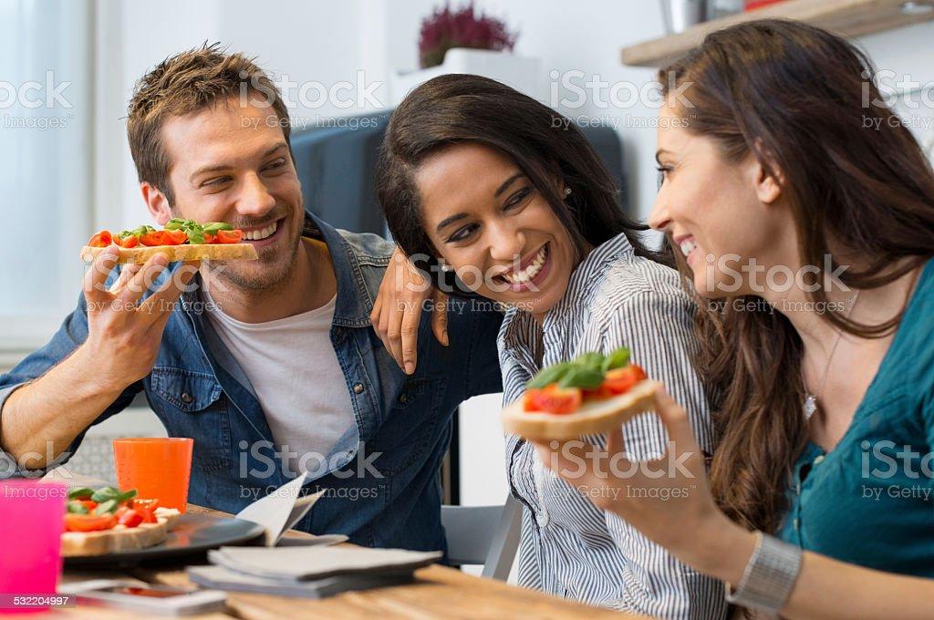 Friends eating bruschetta stock photo