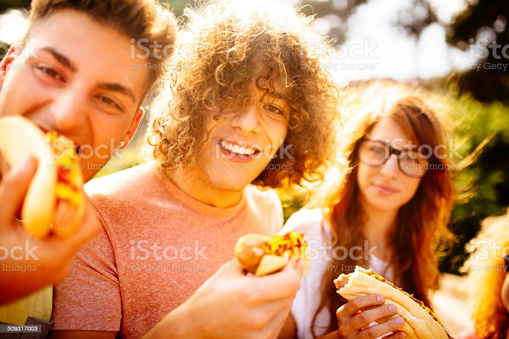 Friends Eating Hotdogs stock photo