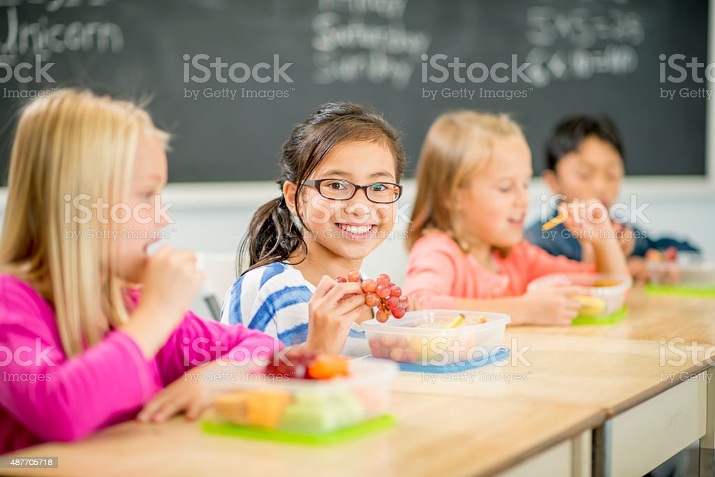 Friends Eating Lunch Together at School stock photo