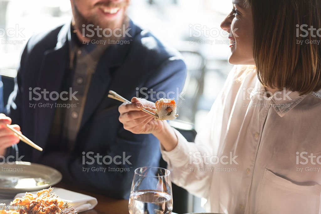 Friends eating sushi stock photo
