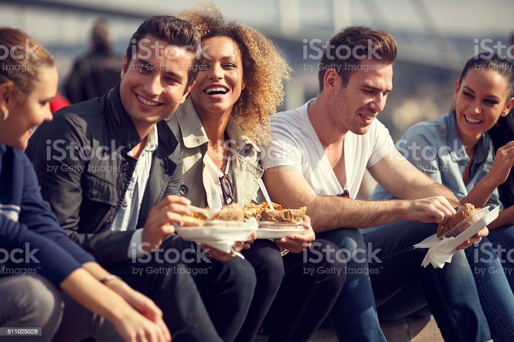 Friends eating turkish baked potato in Ortakoy, Istanbul stock photo