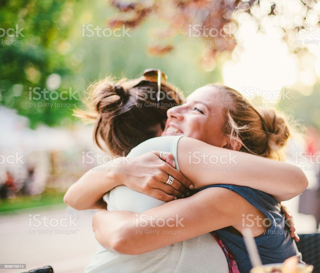 Friends embracing stock photo