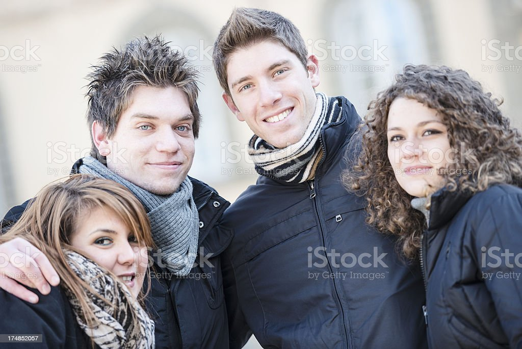 Friends embracing togetherness outdoors royalty-free stock photo