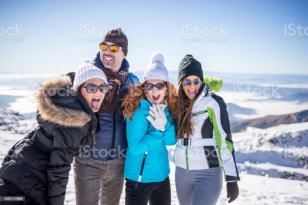 Friends enjoy at the top of mountain stock photo