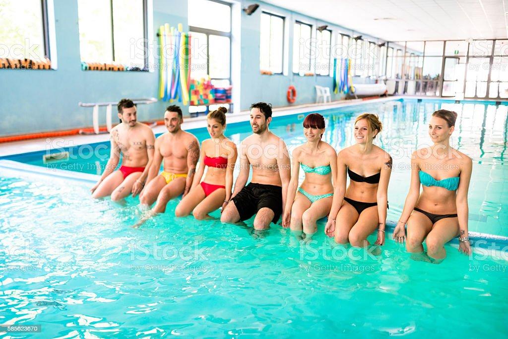 friends enjoy on swimming pool stock photo