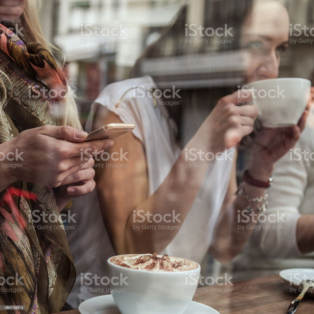 Friends enjoy together a cafe stock photo