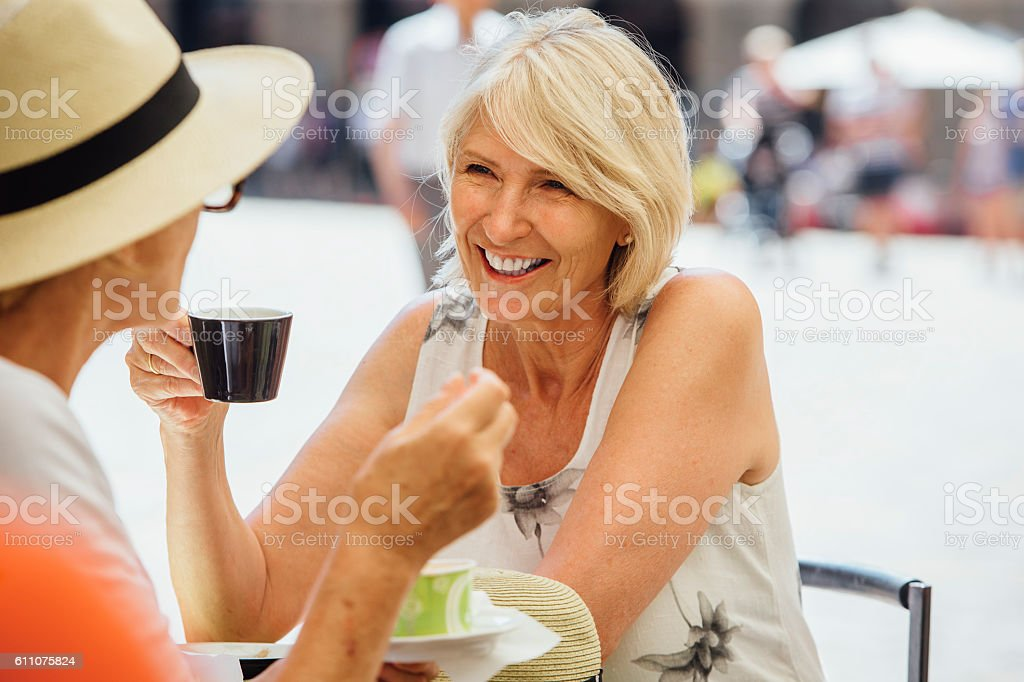 Friends Enjoying a Coffee in Italy stock photo