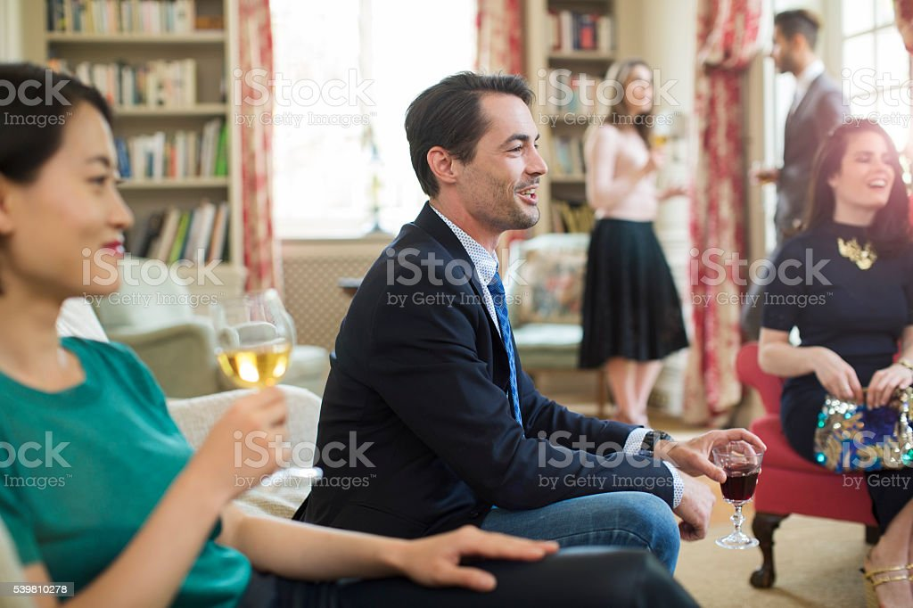 Friends enjoying a conversation in a luxury environment. stock photo