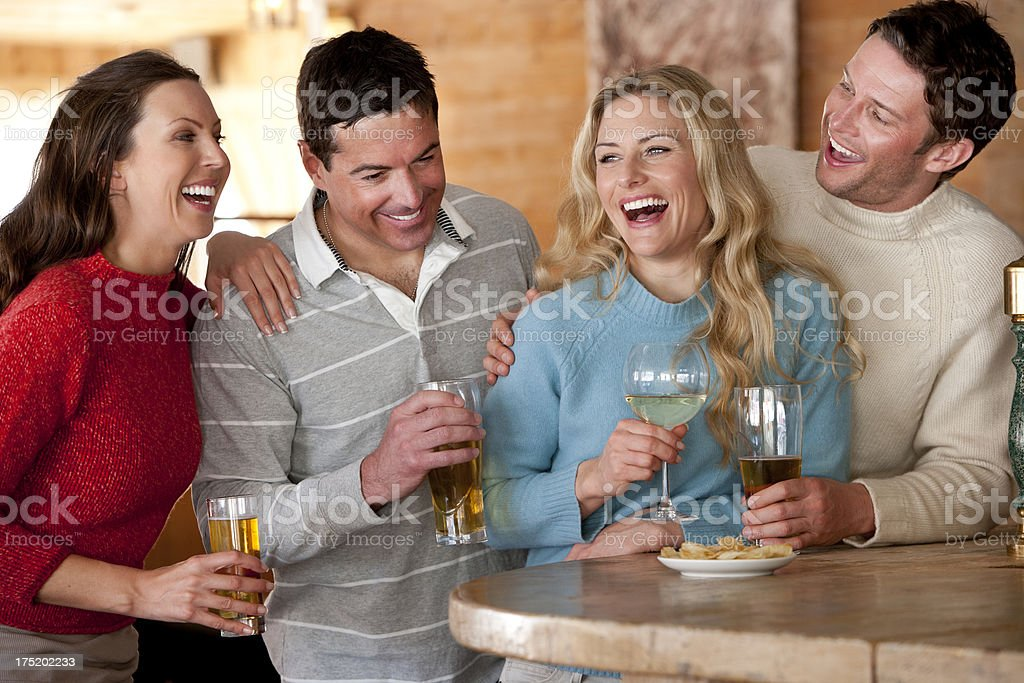 Friends enjoying a drink royalty-free stock photo
