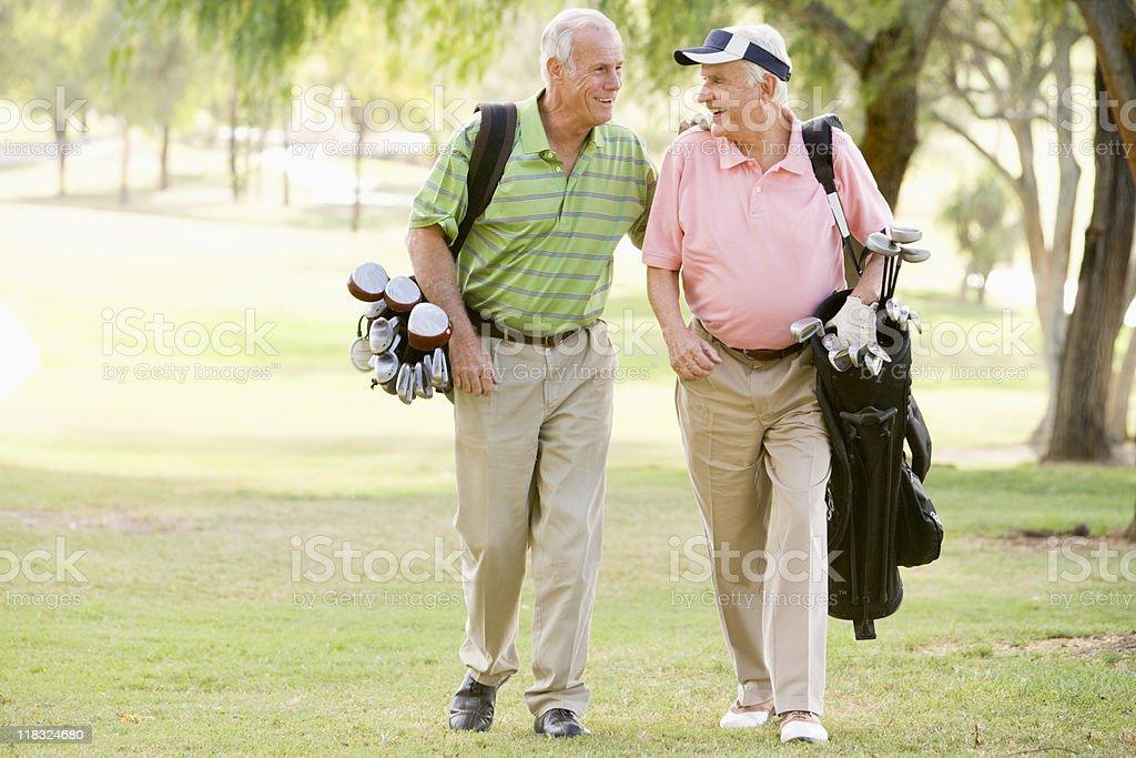 Friends Enjoying A Game Of Golf stock photo