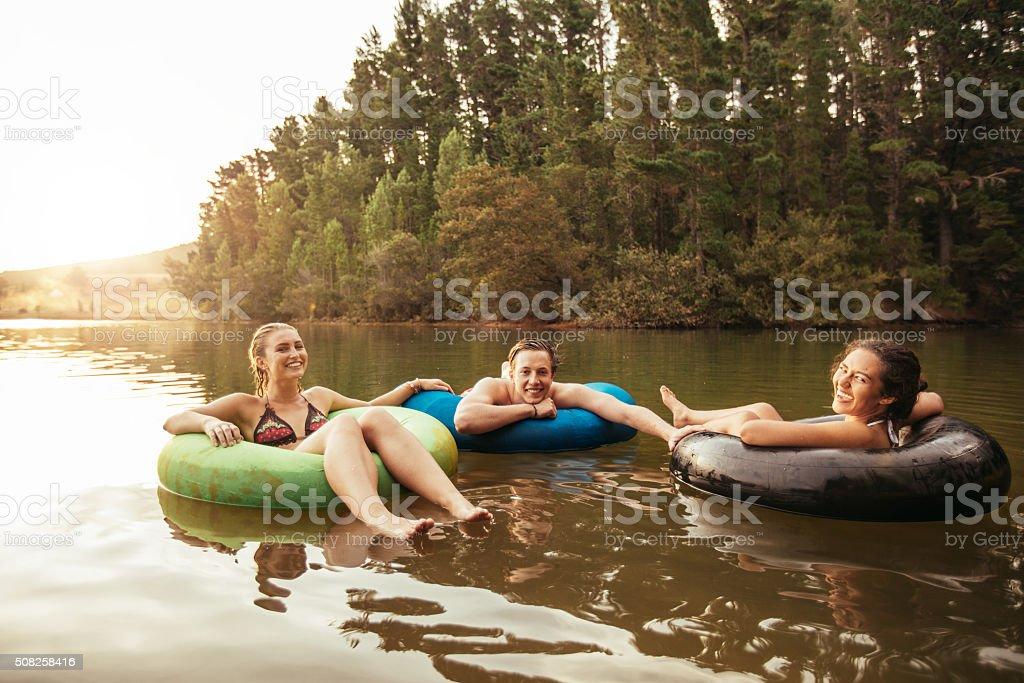 Friends enjoying a holiday at the lake stock photo
