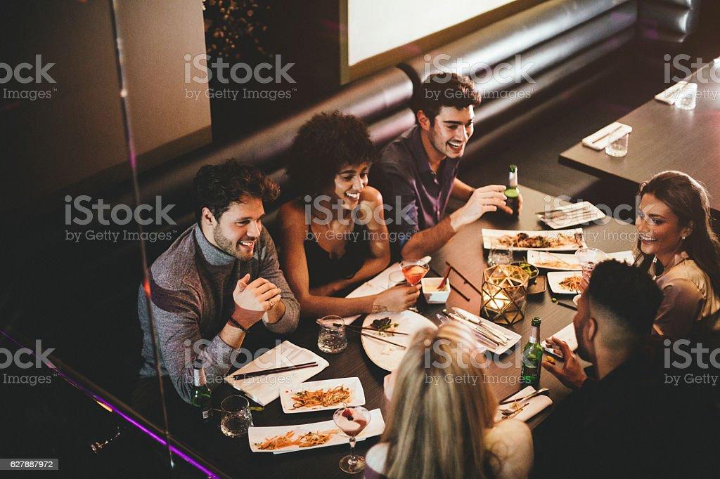 Friends Enjoying a Meal stock photo