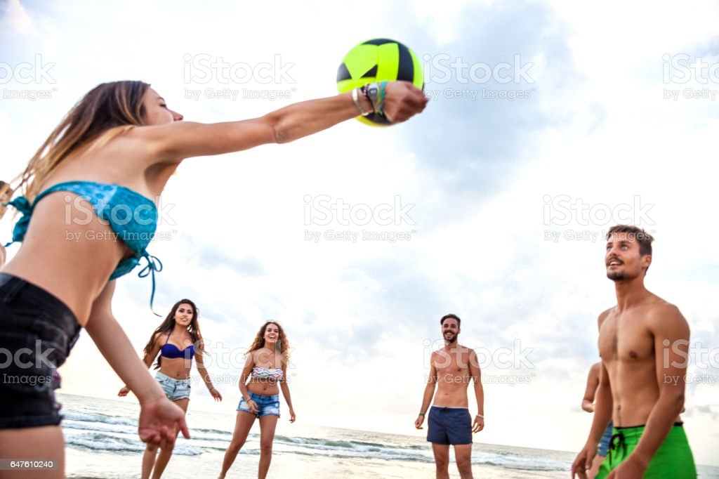 Friends enjoying and having fun a beach holiday stock photo