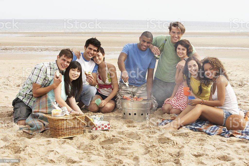Friends Enjoying Barbeque On Beach Together royalty-free stock photo