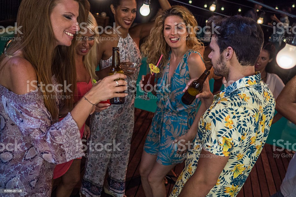 Friends enjoying drinks at poolside stock photo
