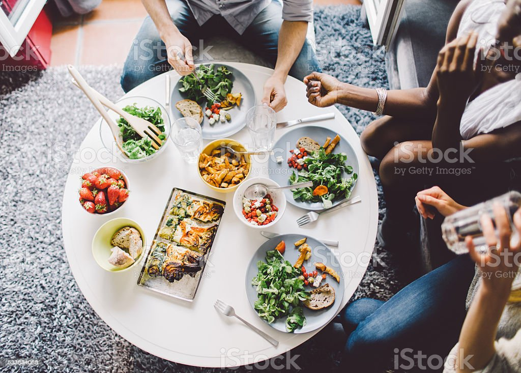 Friends enjoying lunch at home royalty-free stock photo