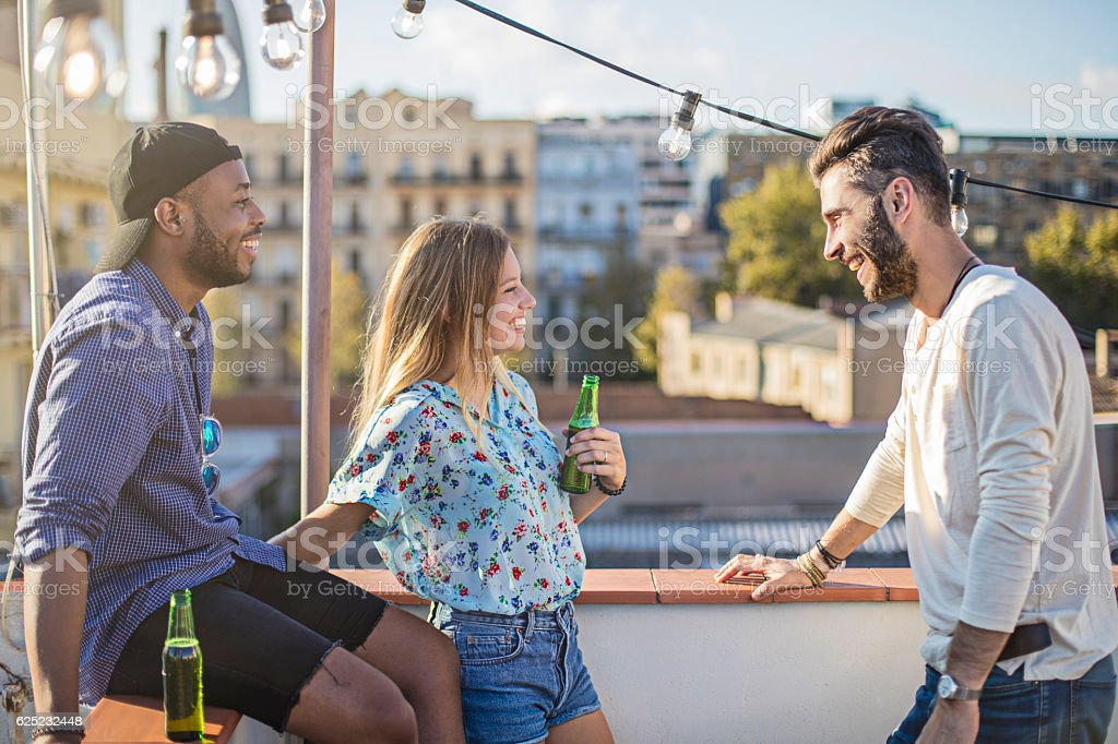 Friends enjoying party on terrace during summer stock photo
