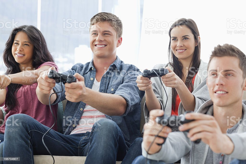 Friends enjoying playing a video game together royalty-free stock photo