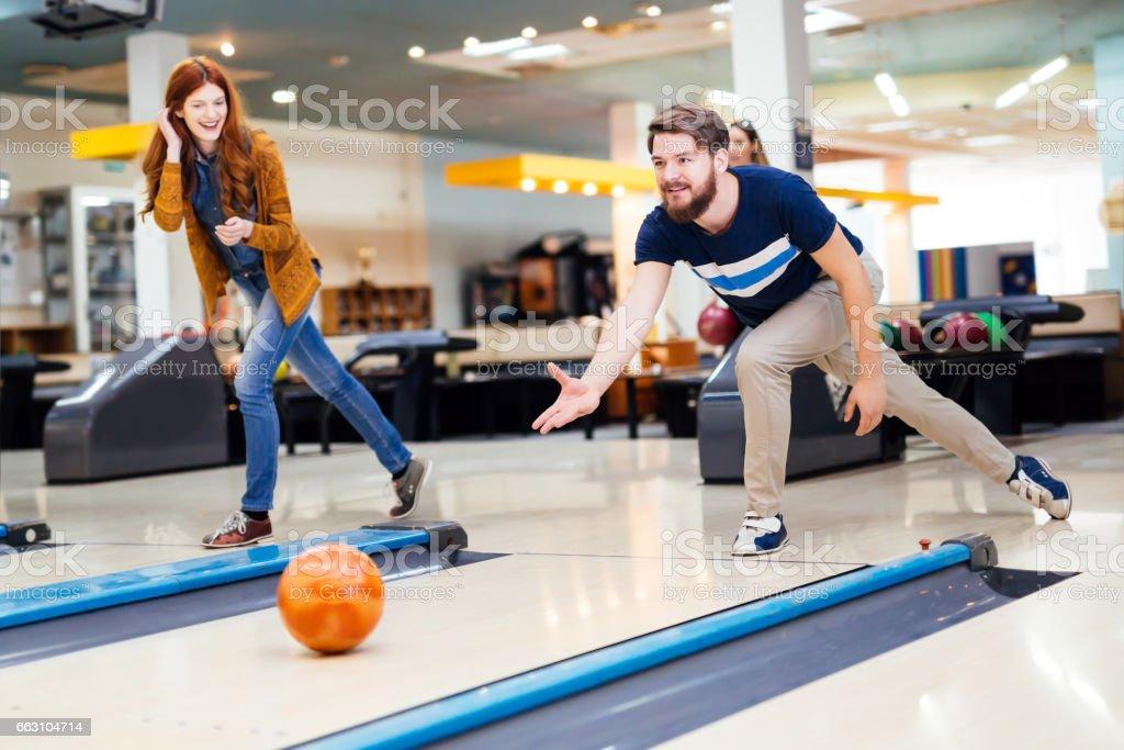 Friends enjoying recreat ional  bowling at club stock photo