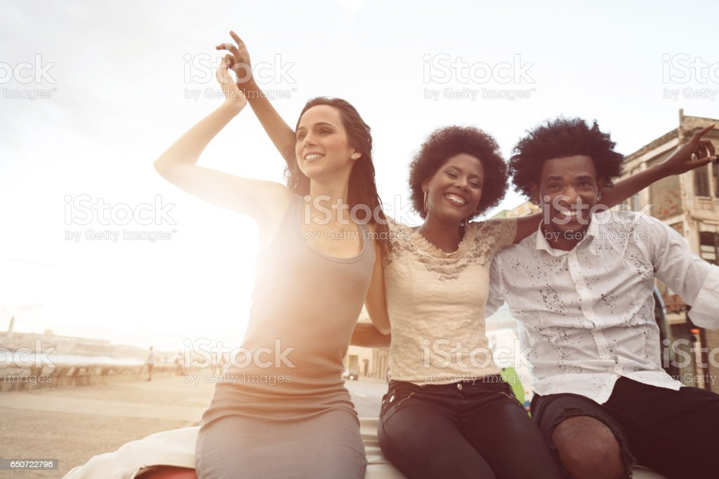 Friends enjoying road trip along the Malecon stock photo