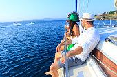 Friends enjoying sailboat ride