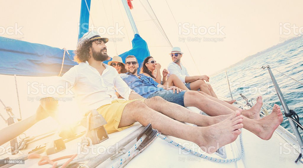 Friends enjoying sailng together stock photo