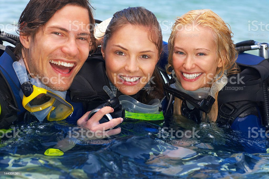 Friends enjoying scuba diving royalty-free stock photo