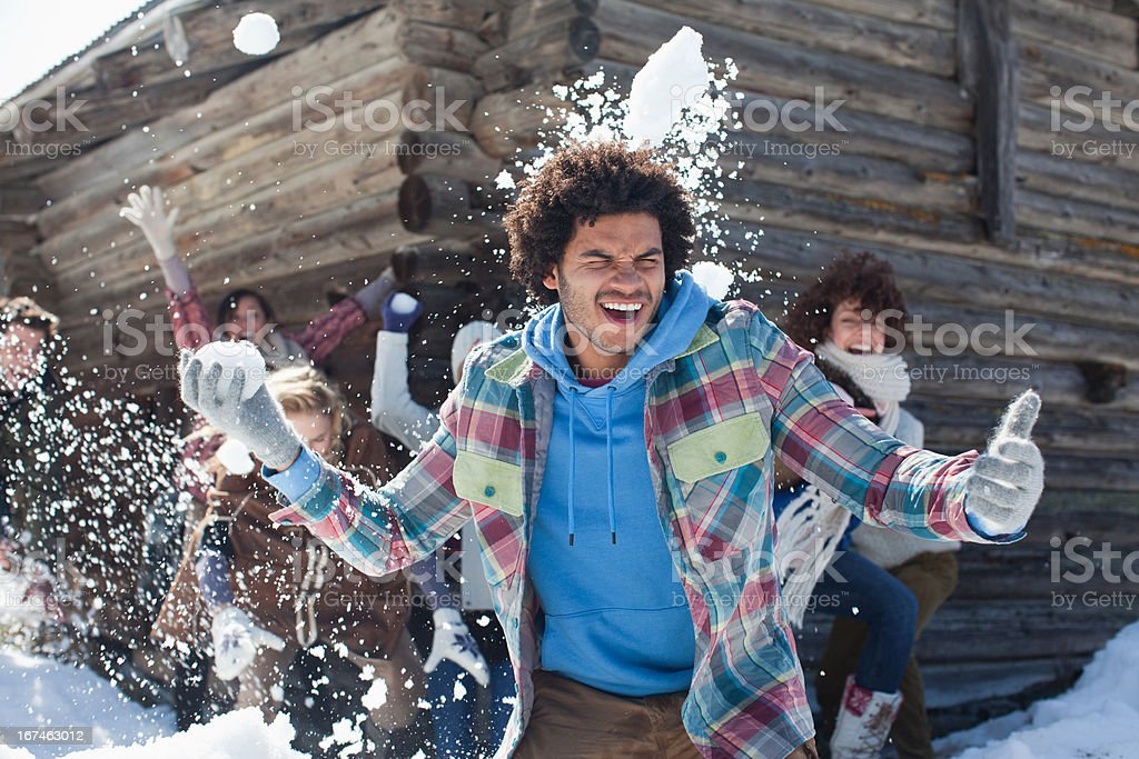 Friends enjoying snowball fight royalty-free stock photo