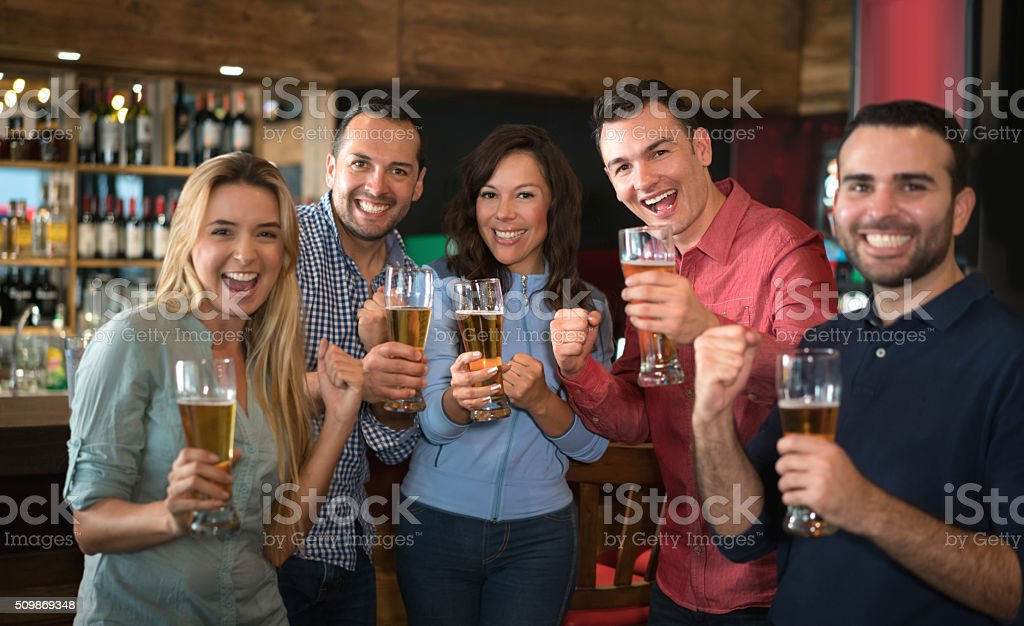 Friends enjoying the happy hour at a bar stock photo
