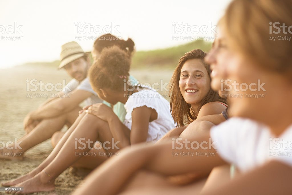 friends enjoying the sunset on beach royalty-free stock photo