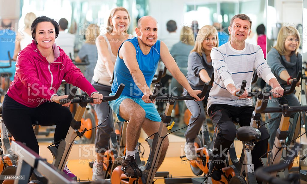 friends exercise in  fitness club stock photo