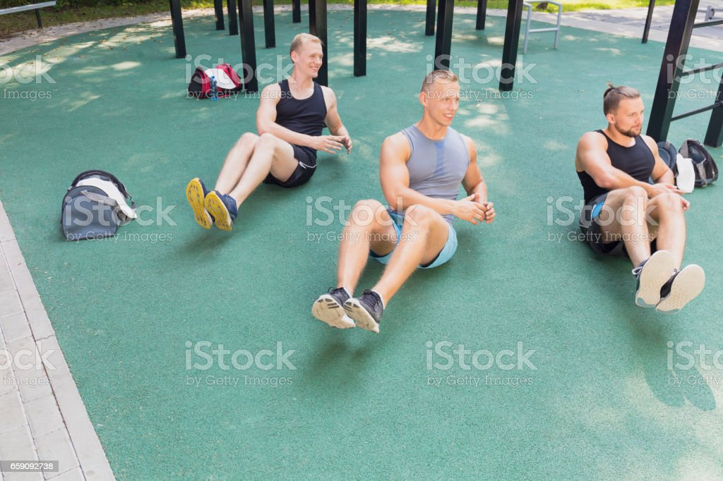 Friends exercising outdoor stock photo