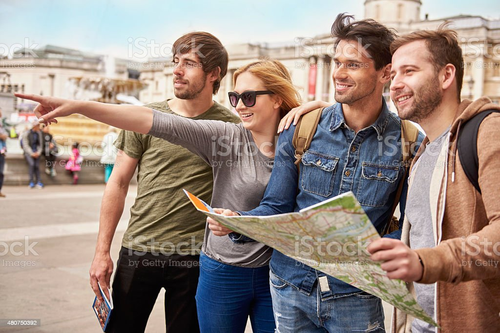 Friends exploring the foreign city stock photo